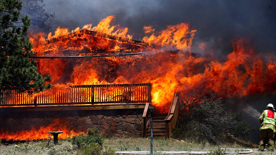Fire consumed a home in Estes Park, Colo., on June 23, 2012. This fire claimed as many as 21 structures. (AP)
