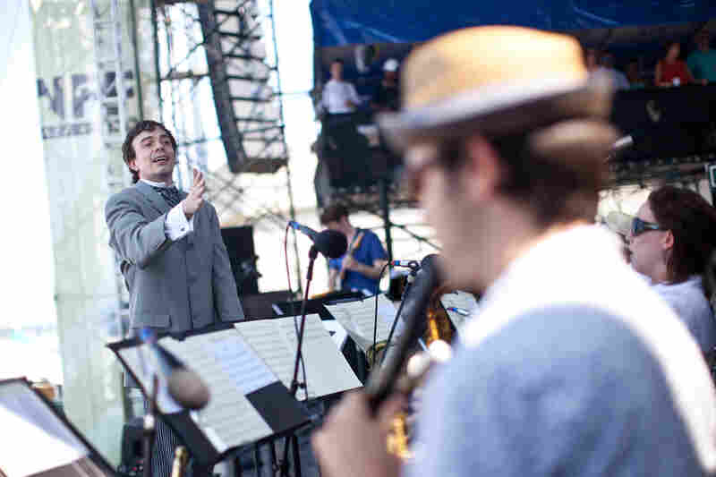 Sharply dressed for the occasion, composer Darcy James Argue led his 18-piece big band, Secret Society, at the main Fort Stage on Saturday.