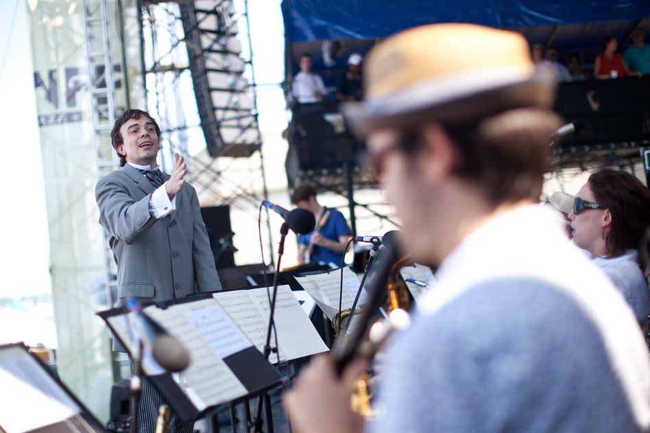 Sharply dressed for the occasion, composer Darcy James Argue led his 18-piece big band, Secret Society, at the main Fort Stage on Saturday. (Erik Jacobs for NPR)