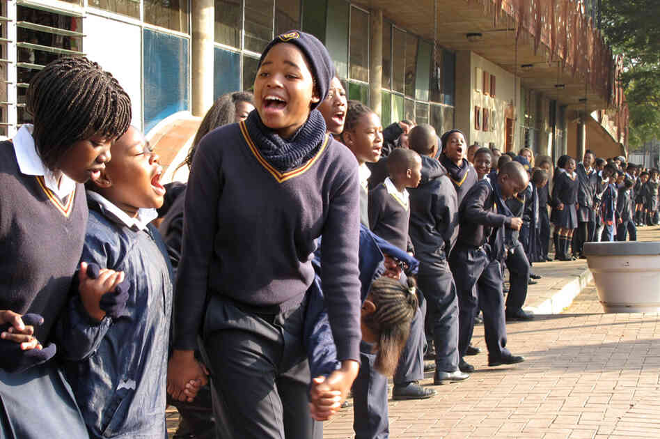 School children singing to Nelson Mandela on his 95th birthday in Johannesburg. The students sang Happy Birthday, spiritual hymns and old anti-apartheid freedom songs.
