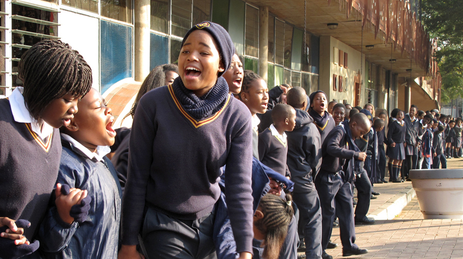 School children singing to Nelson Mandela on his 95th birthday in Johannesburg. The students sang Happy Birthday, spiritual hymns and old anti-apartheid freedom songs. (NPR)