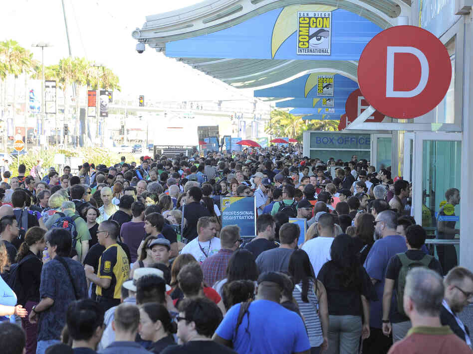 Fans wait in line to get into the Preview Night event on Day 1 of the 2013 Comic-Con International Convention on Wednesday in San Diego.