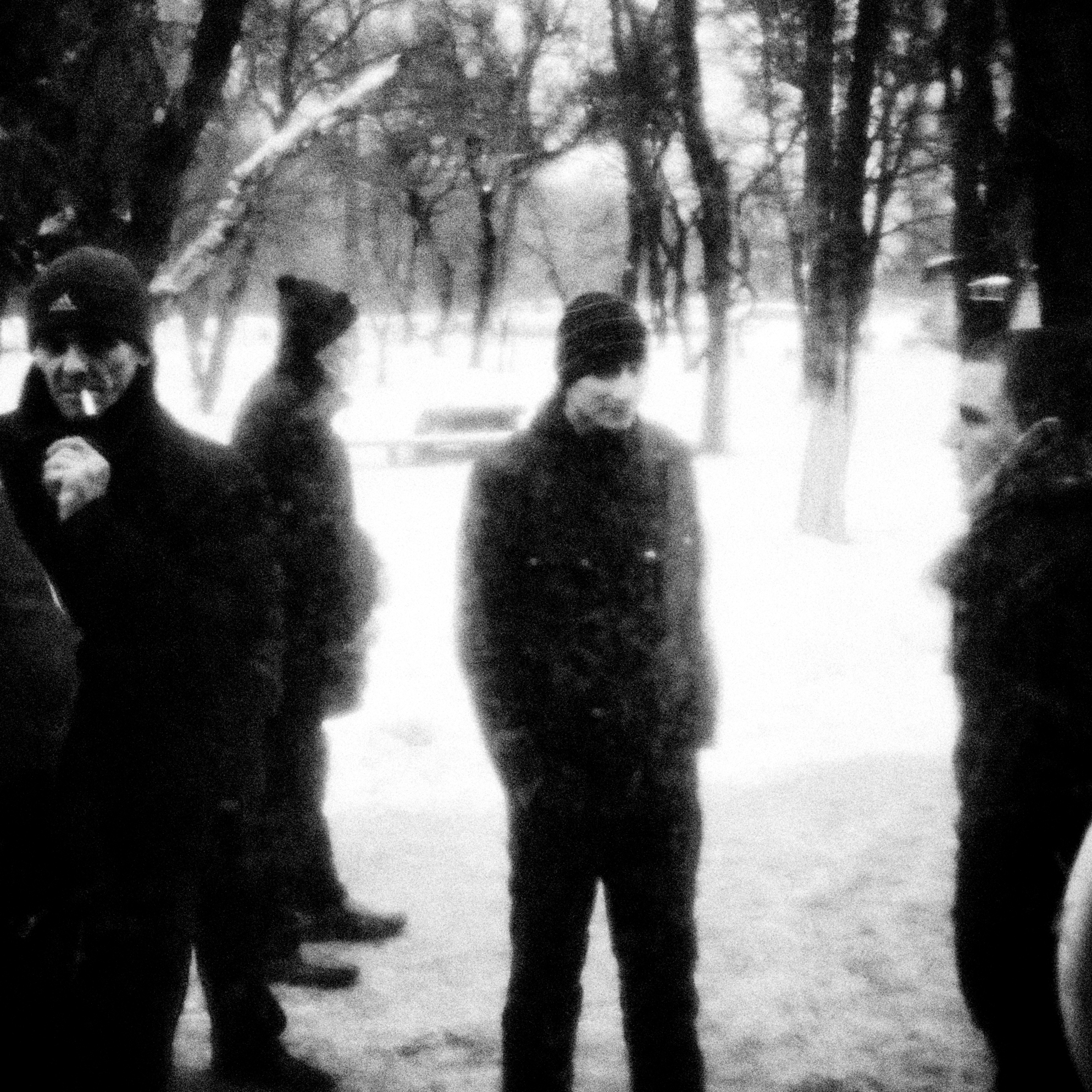 A group of tuberculosis patients with various degrees of drug resistance have a smoke just outside a tuberculosis clinic in Donetsk, Ukraine.