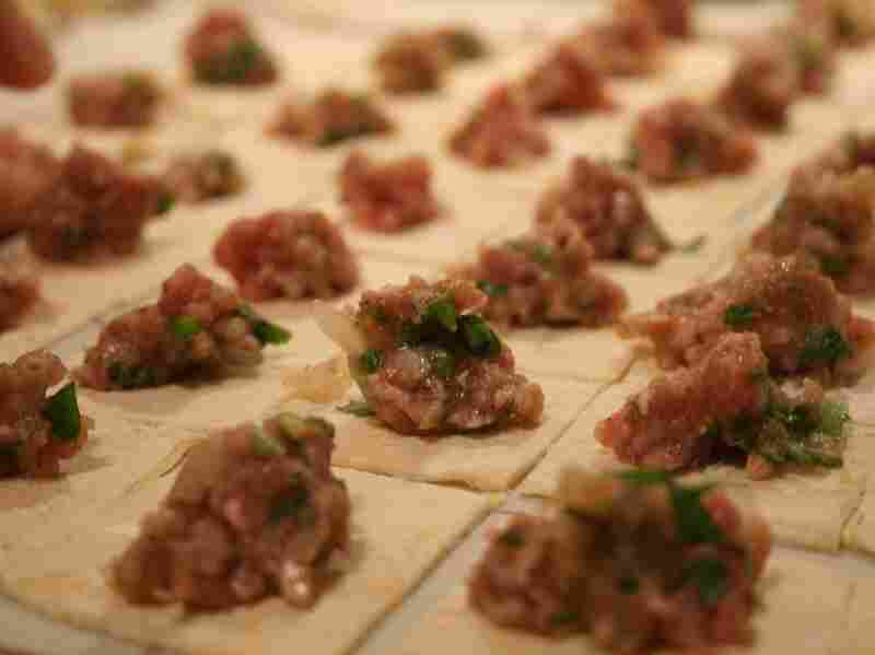 In Turkey, bits of meat are wrapped in squares of pasta to make manti.