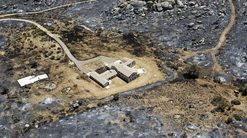 This aerial photo from July 3 shows Yarnell, Ariz., after the Yarnell Hill Fire burned through and claimed the lives of 19 members of an elite firefighting crew.