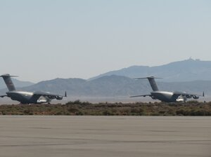 """A pair of C-17 Globemaster IIIs on the ground at Edwards Air Force Base in California, where """"vortex surfing"""" is being tested."""