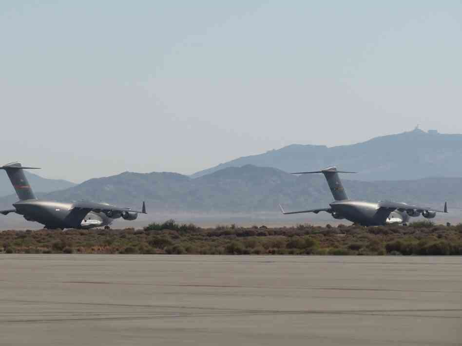 A pair of C-17 Globemaster IIIs on the ground at Edwards Air For