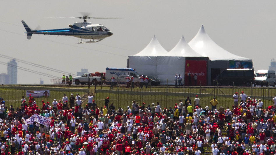 A helicopter carries VIPs to the Brazilian Grand Prix in Sao Paulo in 2010. Politicians taking expensive helicopters and government planes have generated controversy in Brazil. (AFP/Getty Images)
