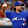 Pitcher R.A. Dickey of the Toronto Blue Jays throws a knuckleball against the Tampa Bay Rays at Tropicana Field in St. Petersburg, Florida.