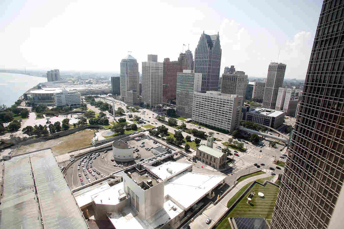 A portion of downtown Detroit along the Detroit river.
