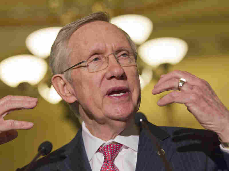 Senate Majority Leader Harry Reid, D-Nev., speaks Tuesday on Capitol Hill. After a compromise, Reid stepped back from a threat to strip the Senate GOP minority of its right to filibuster executive branch nominees.