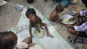 The Indian government's new food security plan would cover impoverished families like this one in the city of Allahabad.