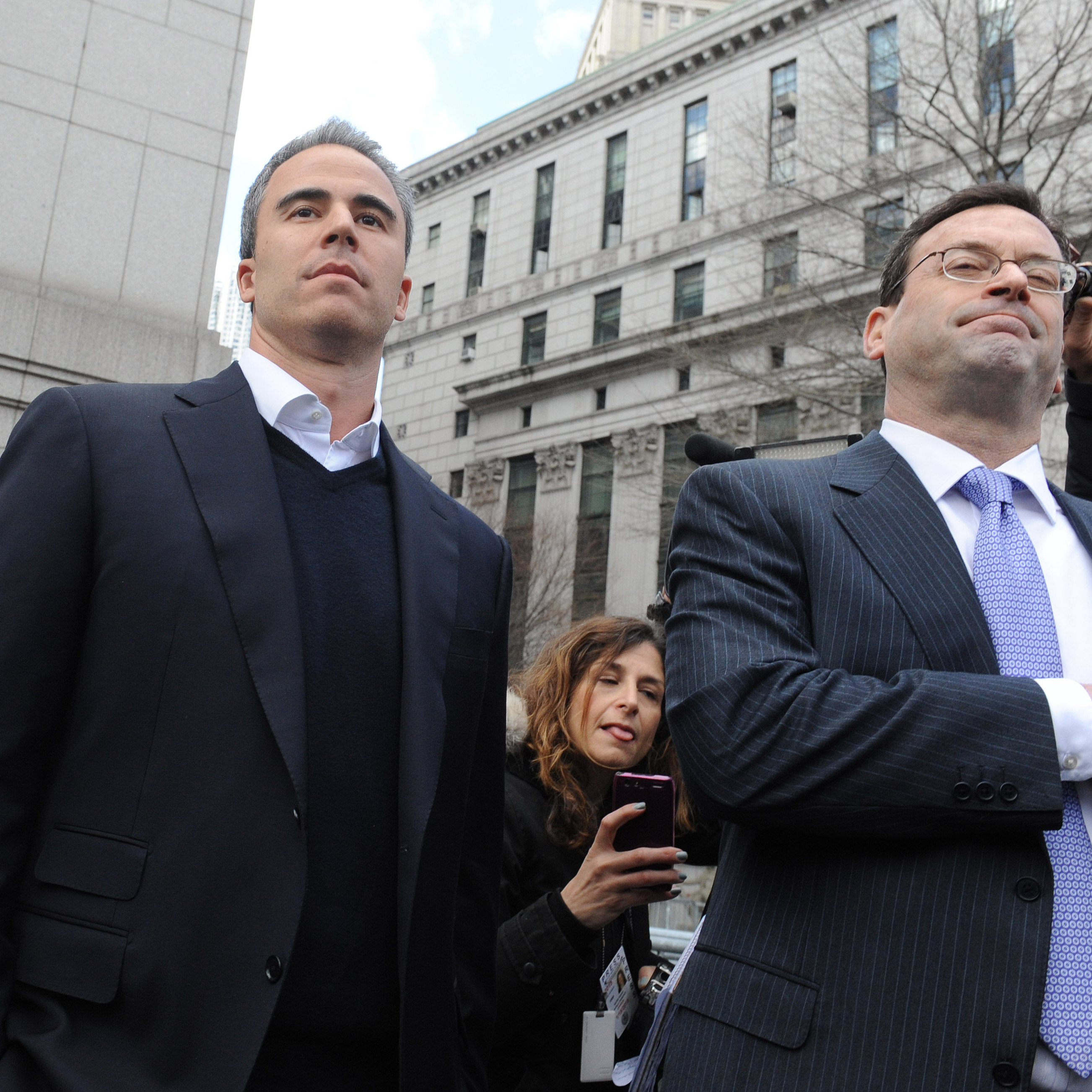 Michael Steinberg (left) exits Manhattan federal court in March after his arrest. Cohen is accused of knowingly allowing Steinberg to make illegal trades.