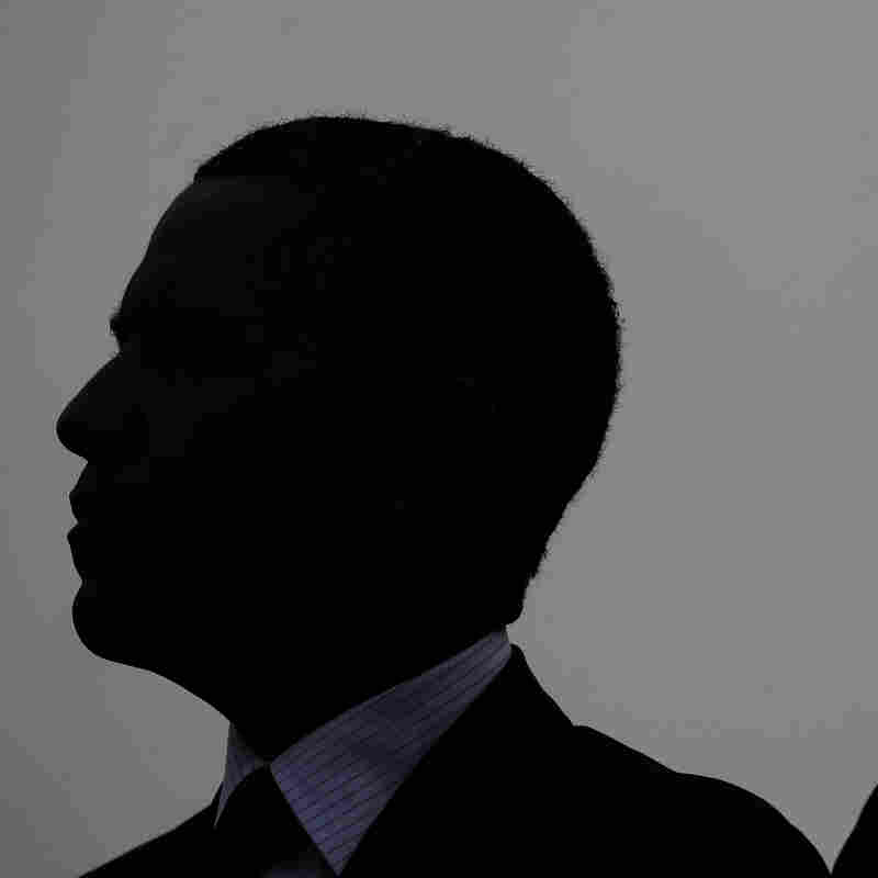 President Obama, left, and Attorney General Eric Holder are silhouetted as they atend the National Peace Officers Memorial Service on Capitol Hill on May 15. In recent days, both Holder and now Obama have talked openly about their experiences as black men in America.