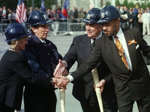 Former Detroit Mayor Dennis Archer, right, and former Gov. John Engler shake hands with Marian and Mike Ilitch during groundbreaking ceremonies at the site of the new Tigers stadium in Oct. 1997. At the time, Archer and Detroit were basking in favorable news coverage.