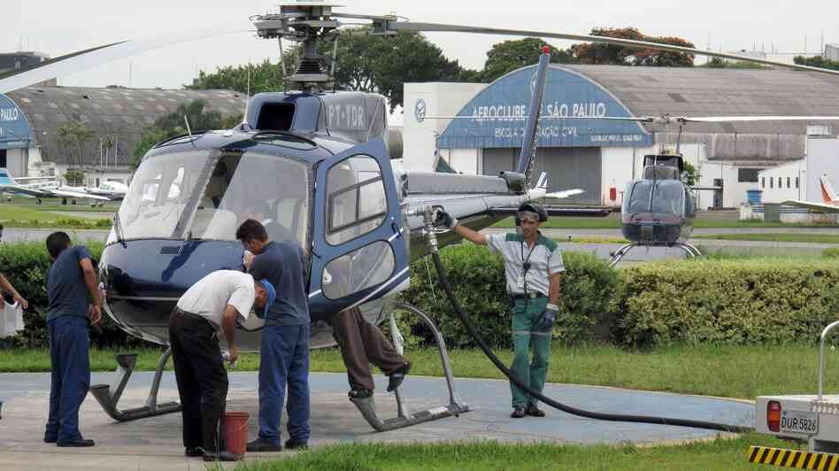 A helicopter is refueled at an airfield in Sao Paulo i