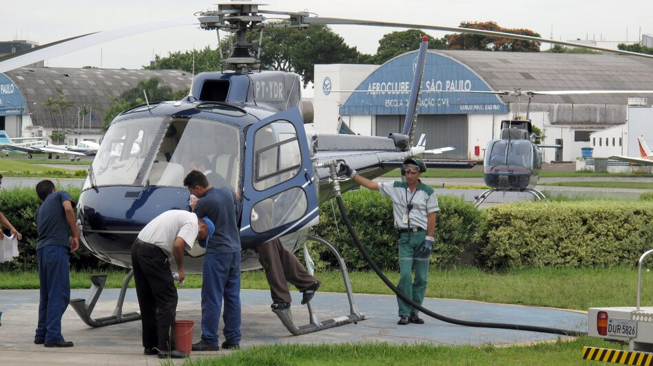 A helicopter is refueled at an airfield in Sao Paulo in 2009. The wealthy rely on helicopters in Brazil to avoid the gridlocked traffic. Politicians who frequently use helicopters, even for short commutes, are now coming under criticism. (Landov)