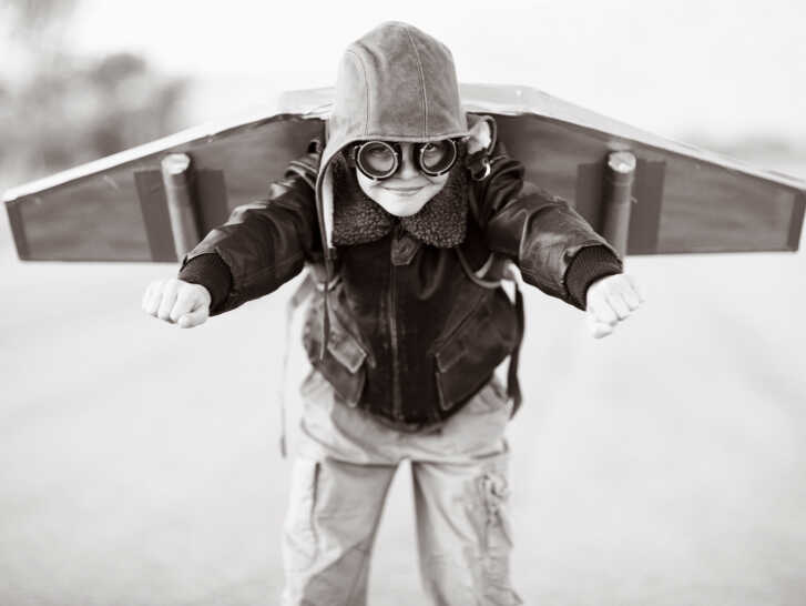 A boy prepares with his jetpack.