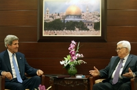 Secretary of State John Kerry meets with Palestinian President Mahmoud Abbas in Ramallah, West Bank, on Friday. Shortly afterward, Kerry announced a