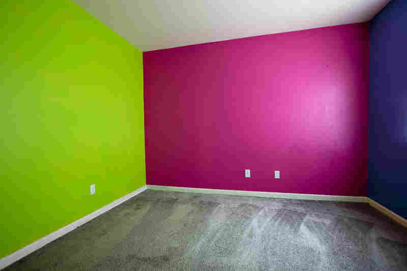 The colorful bedroom walls and freshly cleaned carpet of a foreclosed home in Stockton.