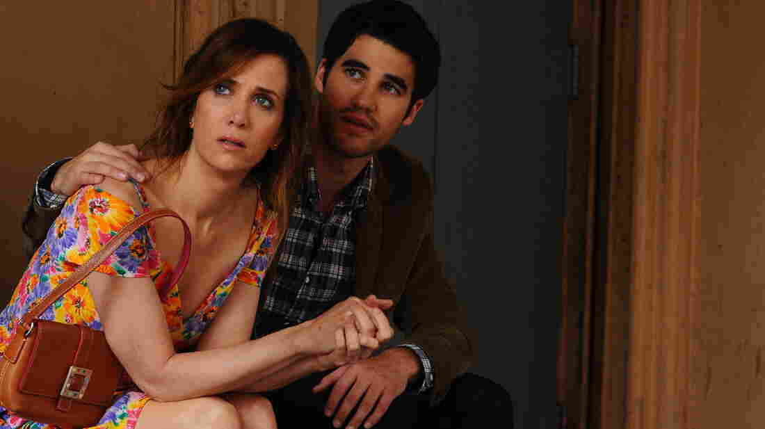 Kristen Wiig (with Darren Criss) stars in Girl Most Likely as a hard-luck case who learns how to reboot her disastrous life after she's forced to move back in with her mom.