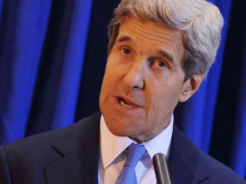 Secretary of State John Kerry speaks during a news  conference at Queen Alia International Airport in