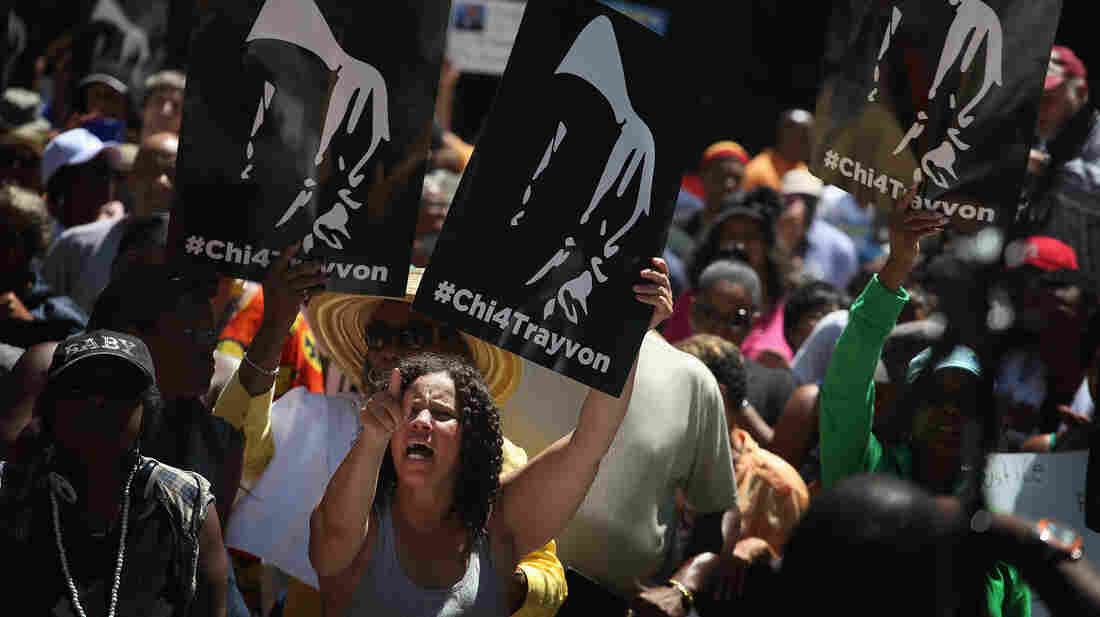 """Demonstrators attend a """"Justice For Trayvon"""" rally in Chicago on Saturday."""