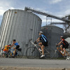 Cyclists pass a grain elevator in The Des Moines Register's annual bike ride across Iowa in 2011. NPR correspondents are joining the ride this year and documenting the journey.