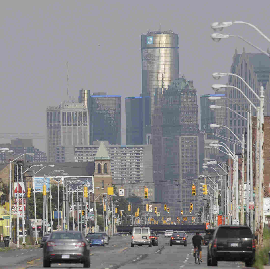 The Detroit skyline gleams from Grand River Ave., a major thoroughfare into some of the city's blighted neighborhoods.