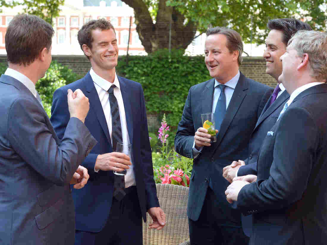Something to cheer about: Scotland's Andy Murray (second from left) speaks with Britain's Deputy Prime Minister Nick Clegg and Prime Minister David Cameron (center) after winning the men's title at Wimbledon.