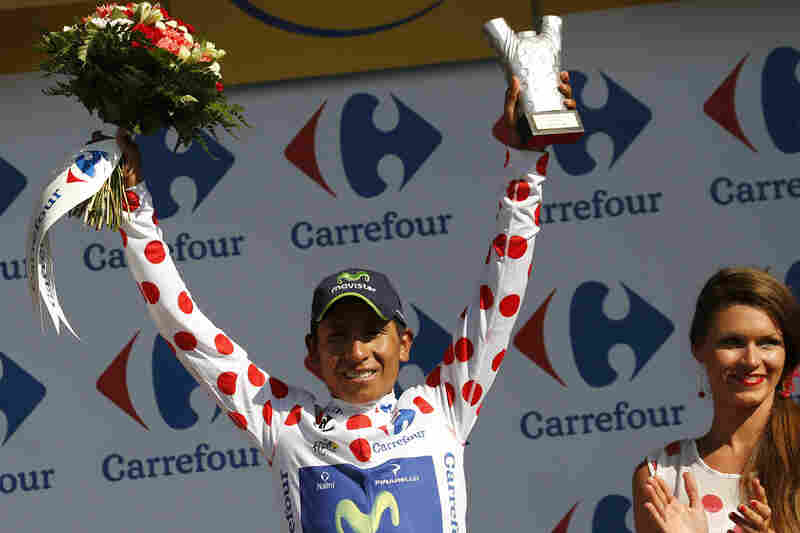 """Colombia's Nairo Quintana celebrates his polka dot jersey, which signifies he's the best climber. In addition to be """"King of the Mountains"""" jersey, Quintana also bears the white jersey signifying the best young rider."""