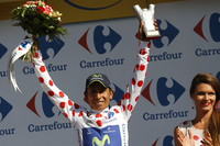 Colombia's Nairo Quintana celebrates his polka dot jersey, which signifies he's the best climber. In addition to be
