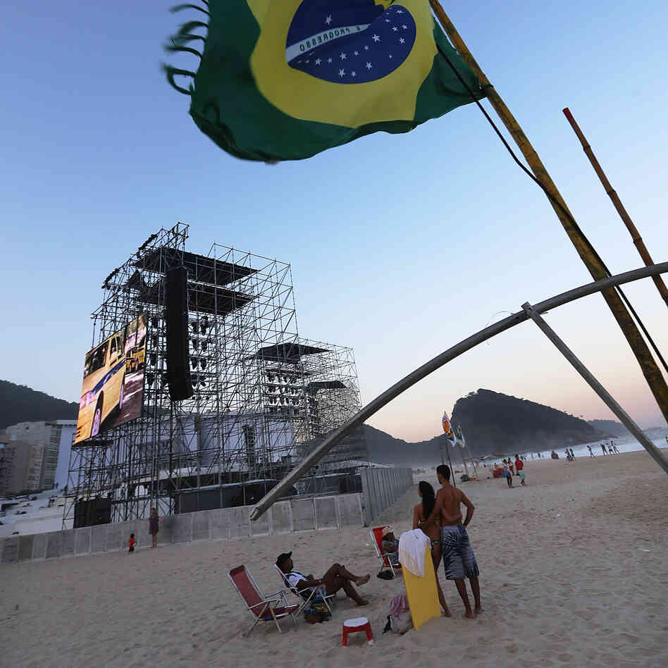 A Brazilian flag flies on Saturday near the podium which will receive Pope F