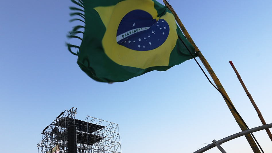 A Brazilian flag flies on Saturday near the podium which will receive Pope Francis on Copacabana Beach in Rio de Janeiro. (Getty Images)