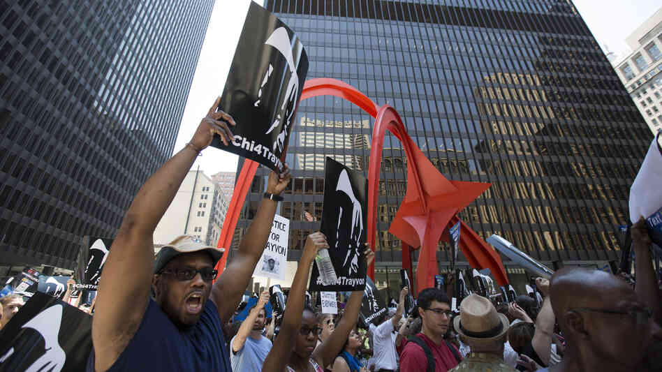 "A man holds up a sign at the ""Justice for Trayvon"" rally in downtown Chicago on Saturday."