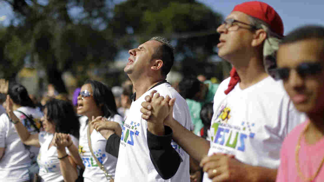 """Evangelical Christians pray during the """"March for Jesus"""" in Sao Paulo, Brazil, Saturday, June 29, 2013."""