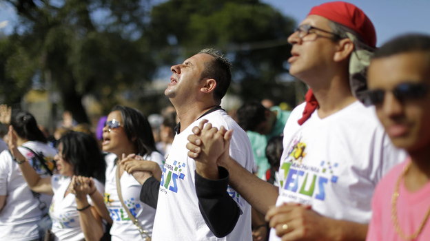 """Evangelical Christians pray during the """"March for Jesus"""" in Sao Paulo, Brazil, Saturday, June 29, 2013. (AP)"""
