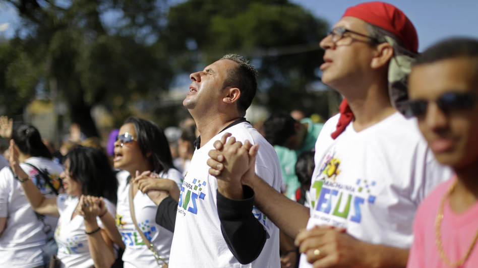 "Evangelical Christians pray during the ""March for Jesus"" in Sao Paulo, Brazil, Saturday, June 29, 2013. (AP)"