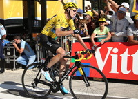 Race leader Christopher Froome of Great Britain finishes Stage 20 of the 2013 Tour de France, clinching is his win of the 21-day race.