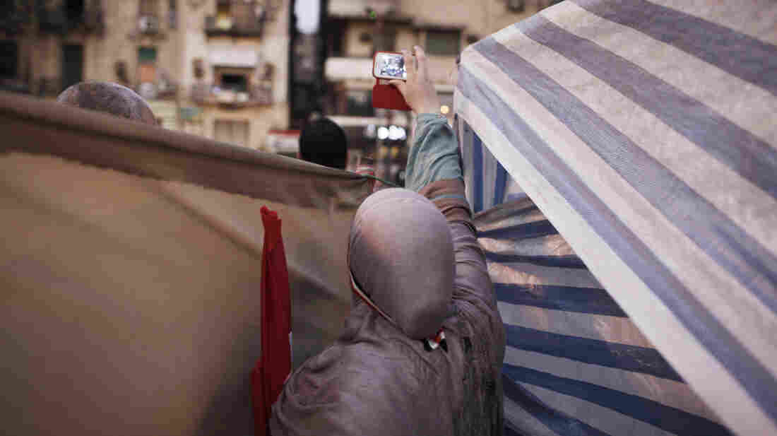 A woman uses her cellphone to record celebrations in Cairo's Tahrir Square on July 4.