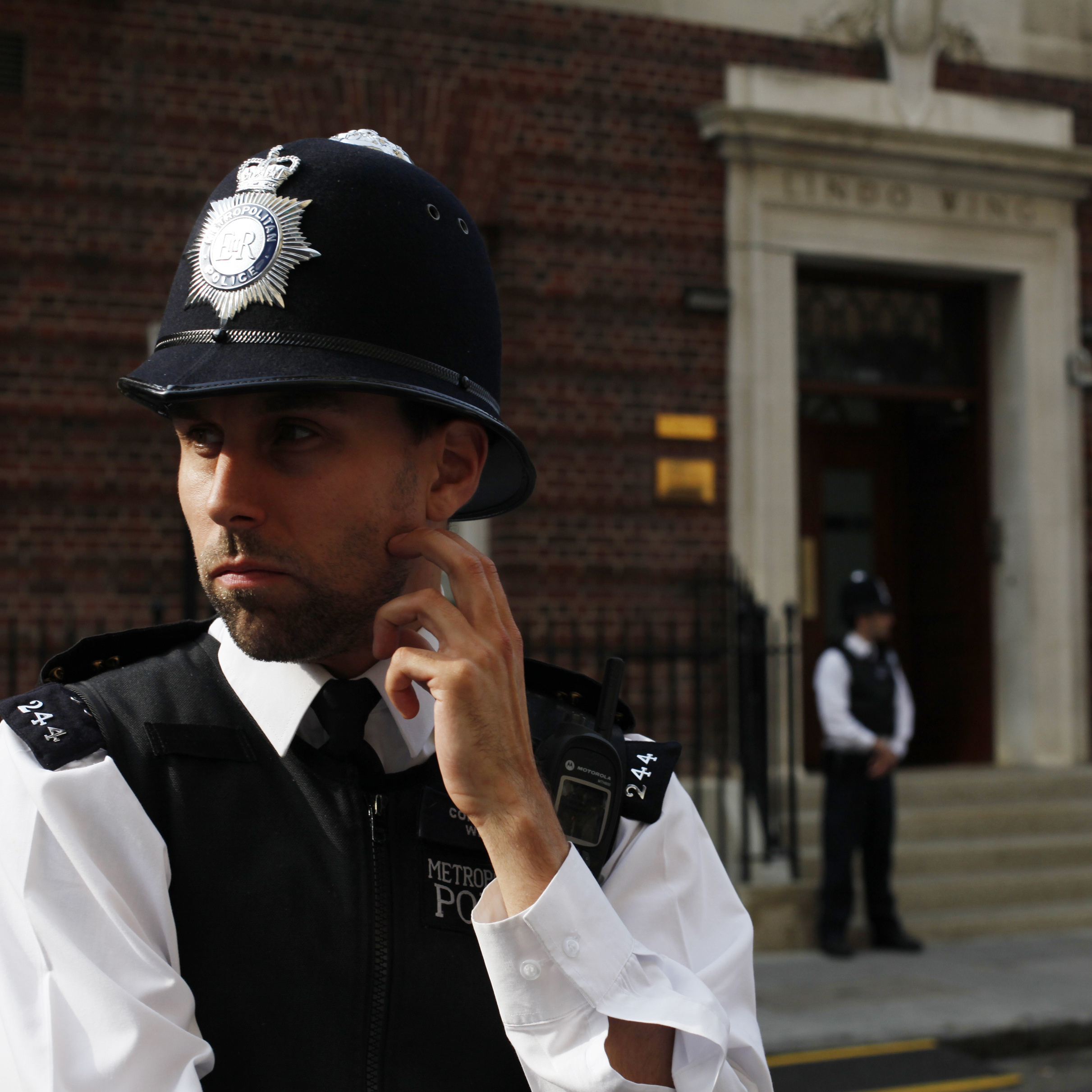 Waiting for word: Police officers stood guard early Monday outside St Mary's Hospital in London, where the Duchess of Cambridge is said to be in labor.
