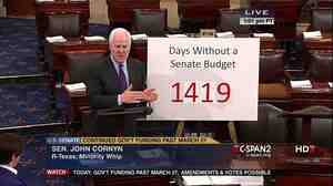 Sen. John Cornyn (R-Texas), with a chart on the budget.
