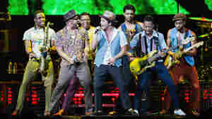 Just One Of The Guys: Bruno Mars (center, with microphone) performs with his band at Key Arena in Seattle, Washington on July 21.