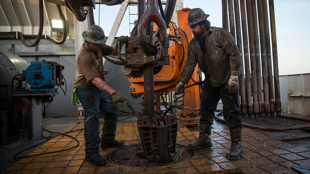 Workers line up pipe while drilling for oil outside Watford City, N.D. While the energy sector has been strong, millions of Americans have been out of work since the recession ended.