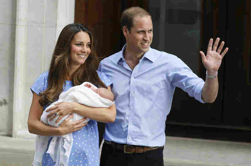 Prince William and Catherine, Duchess of Cambridge, hold the Prince of Cambridge as they pose for photographers outside St. Mary's Hospital in London on Tuesday. The Royal couple is expected to head to London's Kensington Palace from the hospital with their newborn son.