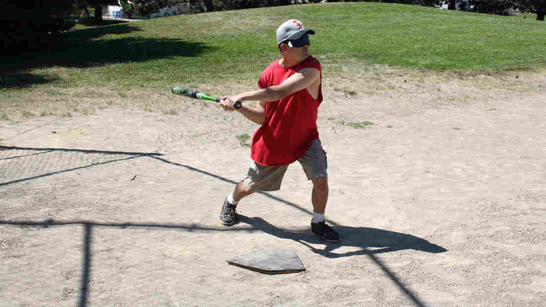 Ryan Strickland takes a practice swing. Even though most players are legally blind, batters, basemen and outfielders all wear blindfolds in Beep Baseball so that people who can see shadows, for example, don't have an advantage.