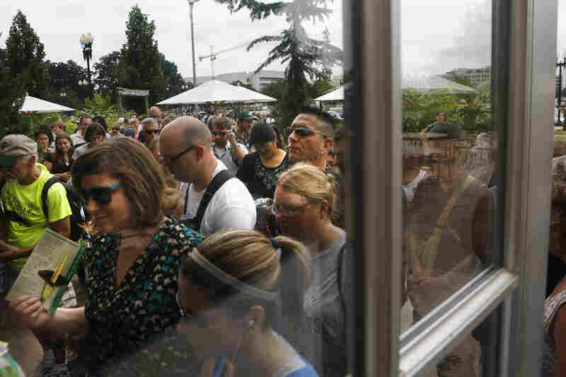 Crowds lined up around the garden to see the flower, known officially as titan arum.