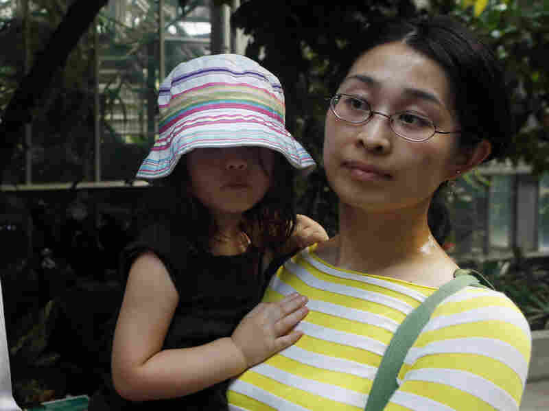 """It's a very strange evolutionary strategy to invest 10 years to make a flower that only last one or two days,"" says Alice Chen, a plant biologist who works at a law firm in Washington. She went to see the corpse flower with her daughter Adie."