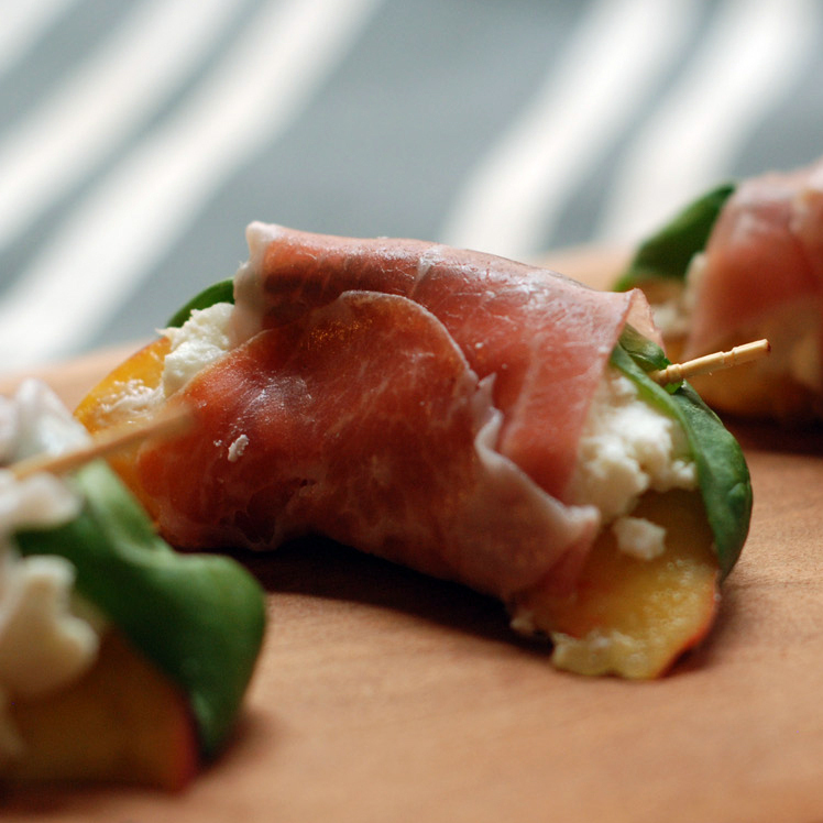 Prosciutto-Wrapped Peaches With Goat Cheese And Basil