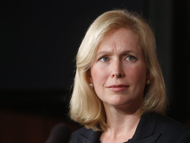 Sen. Kirsten Gillibrand listens during a news conference about a bill regarding military sexual assault cases on July 16, 2013.